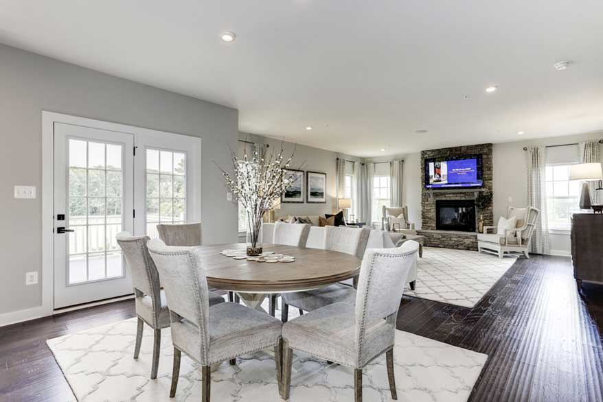 Living area with beautiful dining table and stone fireplace